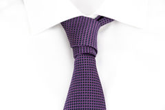 Prince Albert Knot. Purple tie knotted the asymmetric Prince Albert Knot Stock Images