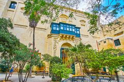 In Prince Alfred`s Court of Grandmaster`s Palace, Valletta, Malt. VALLETTA, MALTA - JUNE 17, 2018: Relax in garden of Prince Alfred`s Courtyard of Grandmaster`s Royalty Free Stock Images