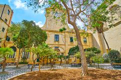 Prince Alfred`s Courtyard of Grandmaster`s Palace, Valletta, Mal. VALLETTA, MALTA - JUNE 17, 2018: The shady garden in Prince Alfred`s Courtyard of Grandmaster`s Royalty Free Stock Images