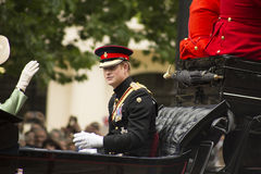 Prince Harry in carriage. London, England - June 13, 2015:  Prince Harry in an open carriage for trooping the colour 2015 to mark the Queens official birthday Royalty Free Stock Images
