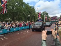 Royal family Windsor. Prince harry kate and will in an open top Range Rover driving down the mall waiving at crowds. Duke and duchess of Cambridge Stock Images