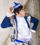 Prince. Man dressed as a prince with a blue hat making a grimace Royalty Free Stock Photography