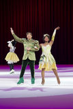 Prince Naveen and Princess Tiana Waving. GREEN BAY, WI - MARCH 10: Waving Prince Naveen and Princess Tiana from Princess and the Frog on skates at the Disney on Royalty Free Stock Photo