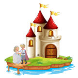 A prince and a princess with a castle at the back Stock Photography