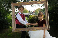Prince and princess. Siblings in a golden frame, playing prince and princess Royalty Free Stock Photography