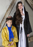 Prince and princess. Young girl with braces dressed as princess and little boy dressed as prince Royalty Free Stock Image