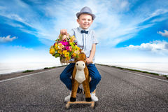 Prince riding a horse.Stylish boy in the hat. Prince riding a horse.Kid`s fashion stock photography