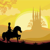 Prince riding a horse to the castle Stock Photo