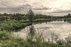 Prince`s Island Park. Bow river seen from Prince`s Island Parks paths royalty free stock image