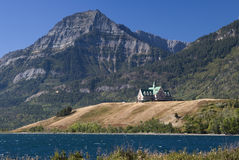 Prince of Wales Hotel. The venerable Prince of Wales Hotel overlooks Waterton Lake, backed by the Rocky Mountains Royalty Free Stock Photography