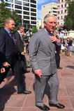Prince of Wales visit to Auckland New Zealand. AUCKLAND - NOV 08 2015:Prince of Wales (C) arrive at Aotea Square, in Auckland New Zealand for a public walk.He is Stock Photos