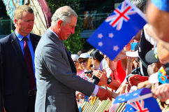 Prince of Wales visit to Auckland New Zealand. AUCKLAND - NOV 08 2015:Prince of Wales (C) arrive at Aotea Square, in Auckland New Zealand for a public walk.He is Stock Image