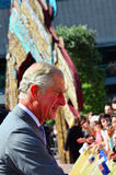 Prince of Wales visit to Auckland New Zealand. AUCKLAND - NOV 08 2015:Prince of Wales (C) arrive at Aotea Square, in Auckland New Zealand for a public walk.He is Royalty Free Stock Images