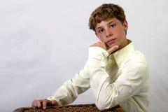 Princely pose. Teenage boy posing Royalty Free Stock Photo