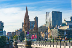 Princes Bridge and St. Pauls Cathedral against Melbourne CBD bui Royalty Free Stock Photography
