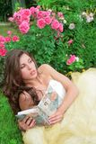 Princes In White-golden Gown With Book Stock Photography
