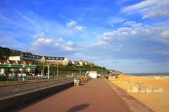 Princes Parade Sandgate Hythe Beach promenade. Sandgate beach promenade and Princes Parade against nice blue sky Folkestone Kent England UK stock photo