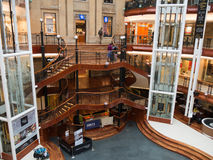 Princes Square shopping mall in Glasgow. GLASGOW, SCOTLAND - 24 JAN 2017: View inside Princes Square shopping mall in Glasgow with its wooden stairs. The old Royalty Free Stock Photos