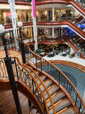 Princes Square shopping mall in Glasgow. GLASGOW, SCOTLAND - 24 JAN 2017: View inside Princes Square shopping mall in Glasgow with its wooden stairs. The old Royalty Free Stock Photo