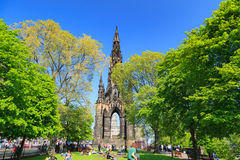Princes Street garden with Scott Monument full of people Royalty Free Stock Images