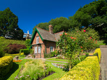 Princes Street Gardens. Cottage in Princes Street Gardens against a blue sky background. One week before the start of the 70th Edinburgh Festival. Best time of stock photography