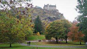 Princes Street Gardens with Edinburgh Castle view on top. royalty free stock photos