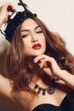A princesa bonita em uma coroa preta Fotos de Stock Royalty Free