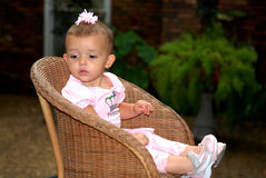 Princess. A cute baby girl wearing all pink with a big bow in her hair and cute pink shoes Stock Photo