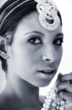 Princess. A monochrome toned headshot of a stunning model, wearing jewlery Royalty Free Stock Photos