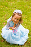 Princess. Closeup portrait of little girl  on green grass Royalty Free Stock Photo