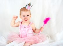 Princess baby with magic wand Royalty Free Stock Image