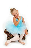 Princess Ballerina. Little girl dressed in blue tutu sitting on her animal print seat Stock Photos