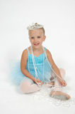 Princess Ballerina. Little ballerina girl with crown on her head and necklace beads drapped around her Royalty Free Stock Image