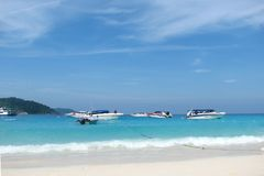 Princess Bay in the Similan Islands, view from the shore. Tourist boats on the blue clear waters of a bay stock photo