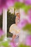 Princess. Beautiful princess strewn with rose petals Royalty Free Stock Images