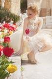 Princess. Beautiful princess strewn with rose petals Stock Photo