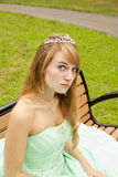 Princess on Bench with Crazy Eyes. Princess sitting on a bench making Crazy Eyes royalty free stock photos