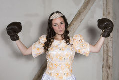 Princess with boxing gloves Stock Image