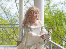 Princess with cat on terrace, half-length portrait Royalty Free Stock Photo