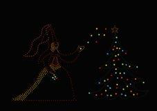 Princess and christmas tree stock image