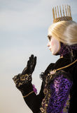 Princess with crown, blondy hair and venetian mask during venice carnival Stock Photo