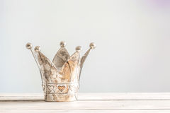 Princess crown on a wooden table stock photos