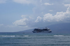 Princess Cruise Ship docked offf coast of Maui with Lanai in th Royalty Free Stock Image