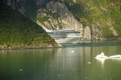 Princess cruises ship sailing in fjord. View Princess cruises ship sailing in Treacy Arm, Alaska. Tracy Arm is a fjord in Alaska near Juneau. Tracy Arm is the stock photo