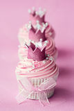 Princess cupcakes. Cupcakes decorated with sugar crowns Stock Image
