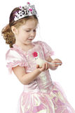 The Princess Dove. An adorable preschool princess holding and stroking the tail of a small white dove.  On a white background Stock Images