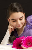 Princess with flowers. Beautiful girl looking to some pink flowers stock images