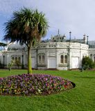 Princess gardens Torquay. Palm tree and hyacinths in public flowerbeds in front of the Pavilion on Torquay promenade stock images