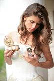 Princess with gift-brooch in hand Stock Images