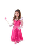Princess girl. Cute little girl dress in a pink princess costume. She has one hand on her hip and is holding a magic wand with her other hand. Isolated on white Royalty Free Stock Photo